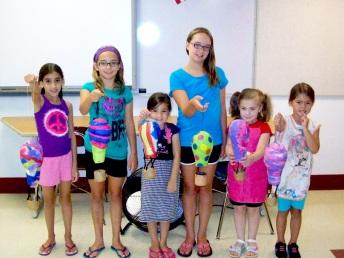Summer Class Showing Off Their Papier Mache Hot Air Balloons